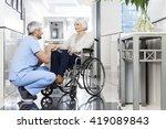 physiotherapist holding senior... | Shutterstock . vector #419089843