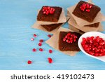 chocolate brownies with garnet. | Shutterstock . vector #419102473