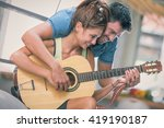 Young Couple Playing Guitar On...