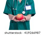 Nurse Holding Green Apple. All...