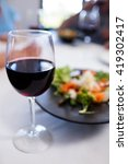 close up of glass of red wine... | Shutterstock . vector #419302417