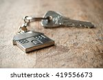 Metallic Key With House Shaped...