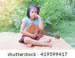 asian little girl sitting... | Shutterstock . vector #419599417