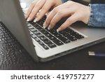 woman uses laptop   Shutterstock . vector #419757277