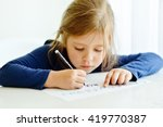 little girl is writing at the... | Shutterstock . vector #419770387