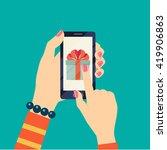 gift  on smartphone screen.... | Shutterstock .eps vector #419906863