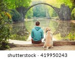 pensive young man sitting on... | Shutterstock . vector #419950243