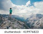 girl watching the italian alps... | Shutterstock . vector #419976823
