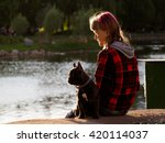 Teen Girl With A Dog Looking A...