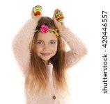 Little Girl Holding Easter Egg...