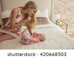 beautiful mom soothes her... | Shutterstock . vector #420668503
