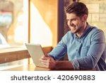 handsome young businessman is... | Shutterstock . vector #420690883