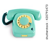 Small photo of Vintage green telephone with rotary dial isolated on white background