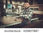 carpenter works on wood plank... | Shutterstock . vector #420857887