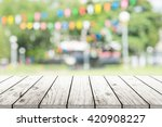 empty wooden table with blurred ... | Shutterstock . vector #420908227