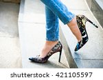 woman in high heel shoes and... | Shutterstock . vector #421105597