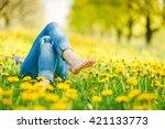 relaxing lying in a meadow in... | Shutterstock . vector #421133773