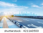 traffic on highway with city... | Shutterstock . vector #421160503