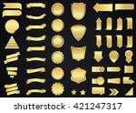 Label vector icon set gold color on black background. Ribbon isolated shapes illustration of gift and accessory. Christmas sticker and decoration for app and web. Banner, badge and borders collection. | Shutterstock vector #421247317