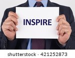 man showing paper with inspire... | Shutterstock . vector #421252873
