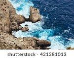 sea waves breaking on a rocks... | Shutterstock . vector #421281013
