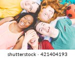 group of four friends laughing... | Shutterstock . vector #421404193