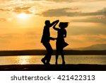 couple dancing salsa at sunset | Shutterstock . vector #421422313