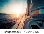 young man standing on the yacht ... | Shutterstock . vector #421443433