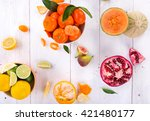 Citrus Fresh Fruits On A Woode...