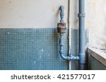 Rusty Pipe On Wall  In Old House
