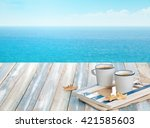 cup of coffee on wooden table... | Shutterstock . vector #421585603