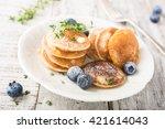 dutch mini pancakes called... | Shutterstock . vector #421614043