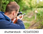 Young Man Shoot With Air Rifle...