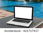 a laptop on the deckchair in... | Shutterstock . vector #421717417