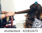 hairdresser doing haircut for... | Shutterstock . vector #421812673