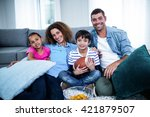 portrait of family watching... | Shutterstock . vector #421879507