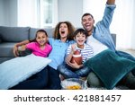 family watching american... | Shutterstock . vector #421881457