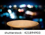 empty wooden table on blur... | Shutterstock . vector #421894903
