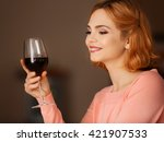 young woman with glass of red... | Shutterstock . vector #421907533