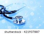 stethoscope on light blue... | Shutterstock . vector #421937887
