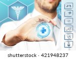doctor hand holding virtual... | Shutterstock . vector #421948237