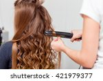 stylist curling hair for brown... | Shutterstock . vector #421979377