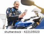 handsome biker using mobile... | Shutterstock . vector #422135023