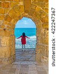 Small photo of The girl watch the storm from the balcony of the old fortress, Acre, Israel.