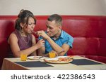 young couple feeding each other | Shutterstock . vector #422386543