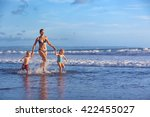 happy barefoot family having... | Shutterstock . vector #422455027