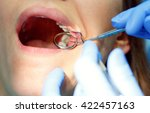 close up woman getting a dental ... | Shutterstock . vector #422457163