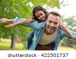 father giving a piggyback ride... | Shutterstock . vector #422501737