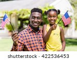 happy family showing usa flag... | Shutterstock . vector #422536453