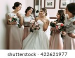 bridesmaids in the pink skirts... | Shutterstock . vector #422621977